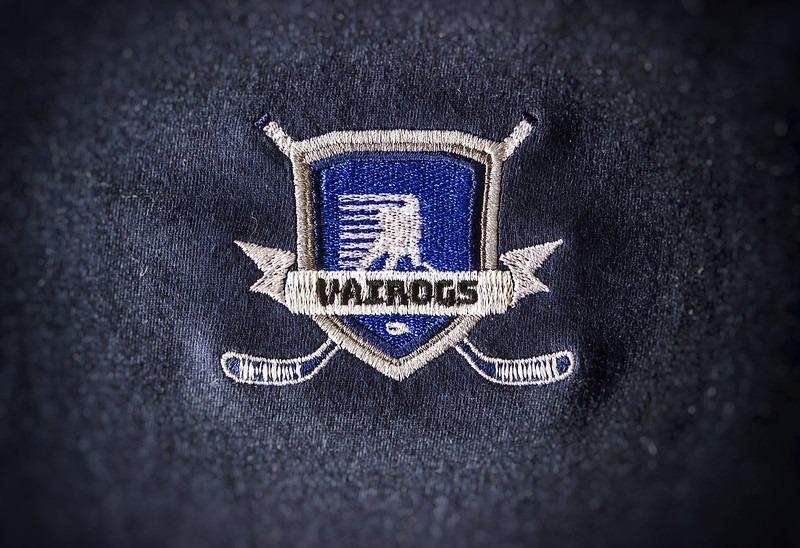 izšūtu logo